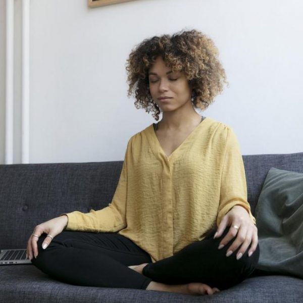 person-meditating-on-the-sofa